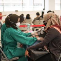Screening kepada penerima vaksin di Exhibition Hall